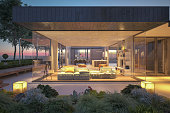 istock Modern House Outdoors At Night 1225769230