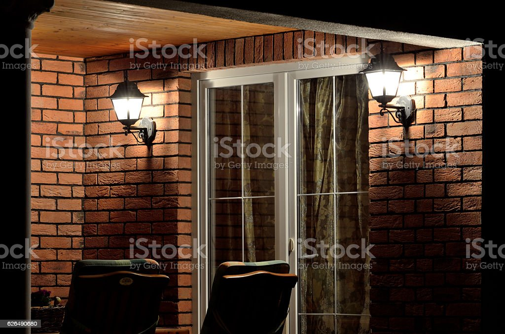 Modern house terrace (patio) with garden furniture at night stock photo