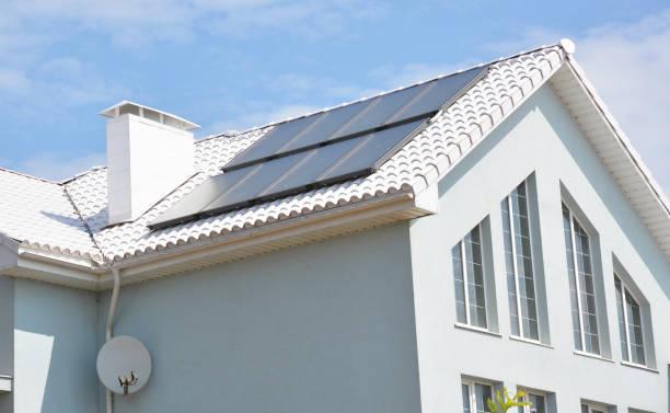 modern house with energy efficiency solution concept roof.  house  with solar energy, solar panels - solar panel imagens e fotografias de stock