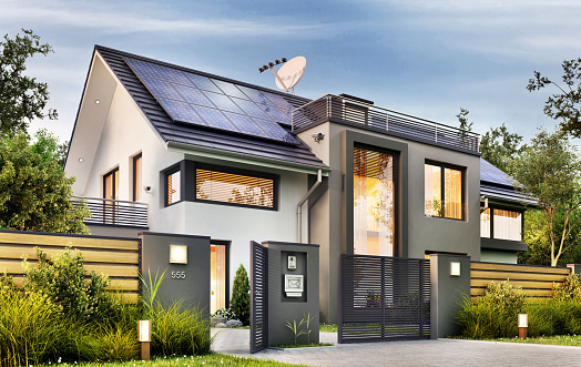 Beautiful modern house with garden and solar panels on the gable roof
