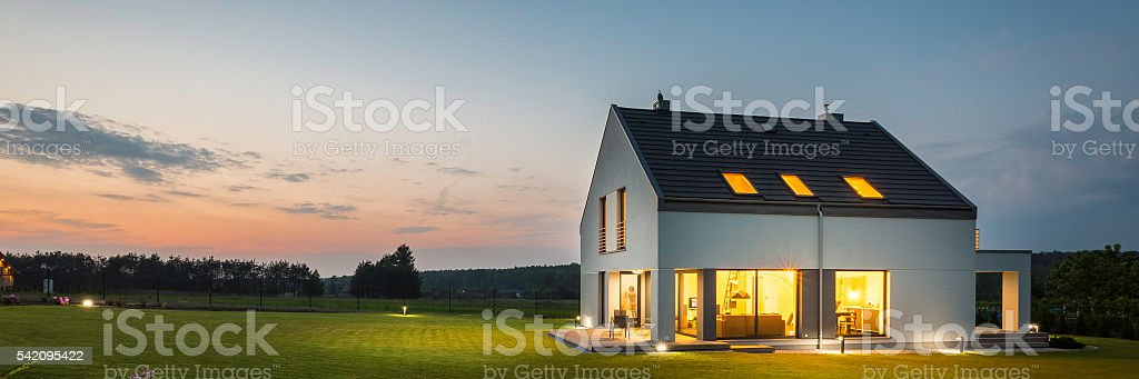 Modern house with garden at night stock photo