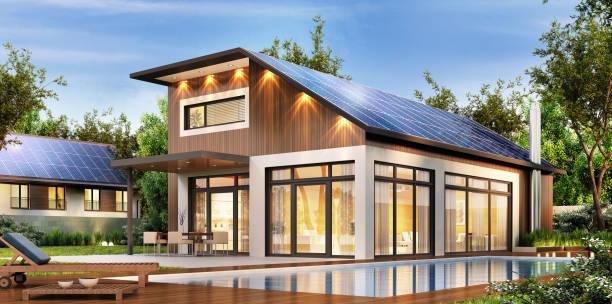 modernes haus mit solarzellen auf dem dach - solaranlage stock-fotos und bilder