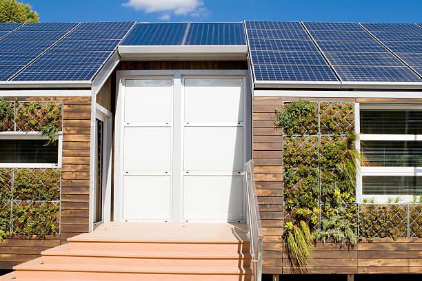 modern house with solar photovoltaic panels, gray water plant wall - solar panel bildbanksfoton och bilder
