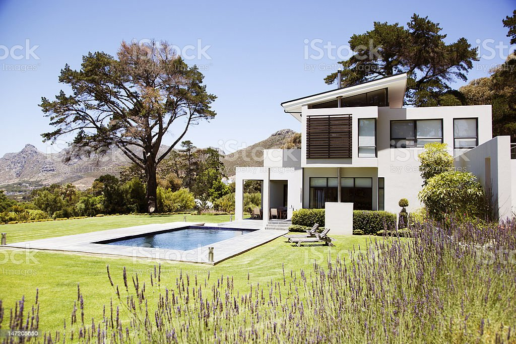 Modern house with swimming pool stock photo