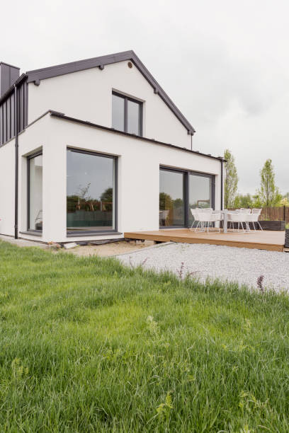 Modern house with white facade Picture of modern house with white facade war effort stock pictures, royalty-free photos & images