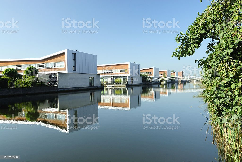 Modern houses along water in the Netherlands royalty-free stock photo