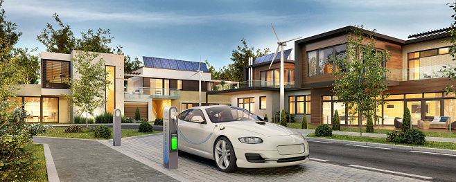 Street with modern houses with solar panels and electric car