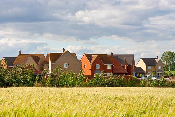 Modern housing Modern housing  in Suffolk, UK housing development stock pictures, royalty-free photos & images