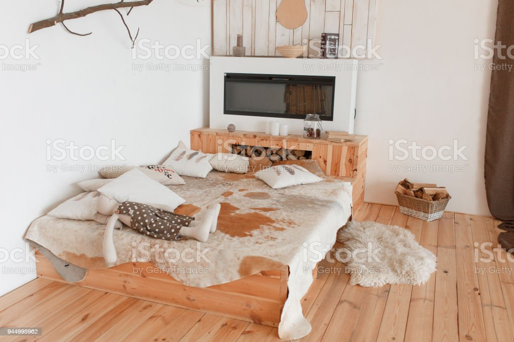 Modern Hunting House Bedroom Interior With Fireplace And Animal Skin On Bed  Royalty Free Stock