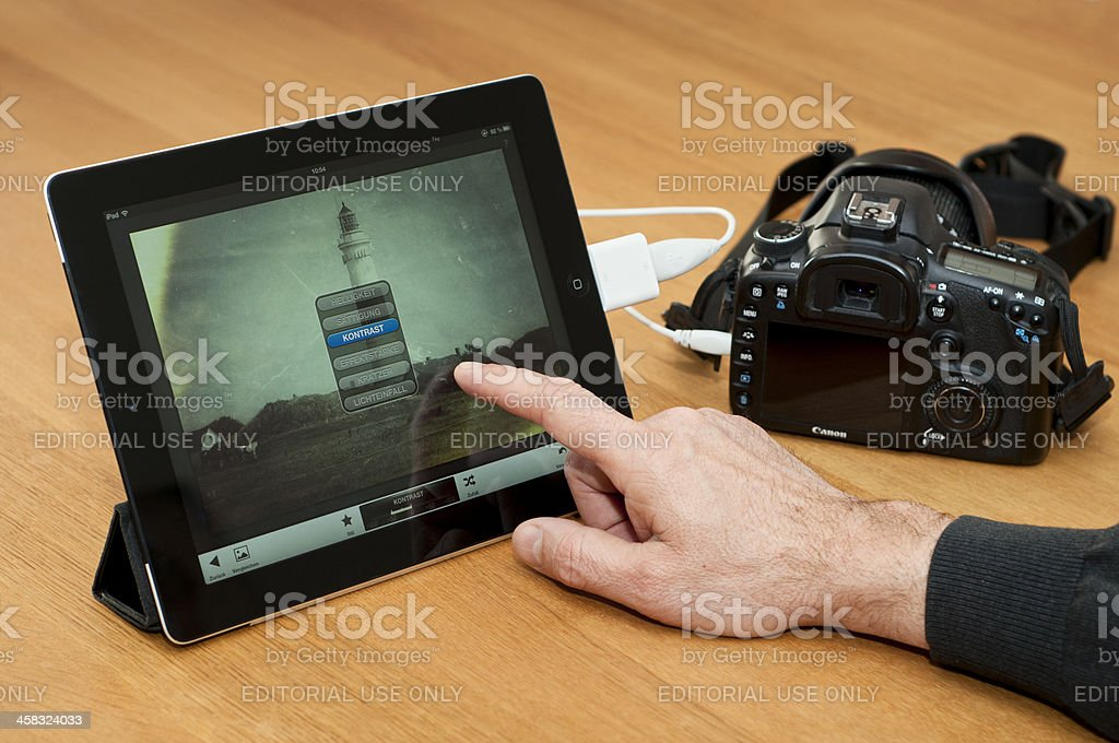 Modern image processing on iPad royalty-free stock photo