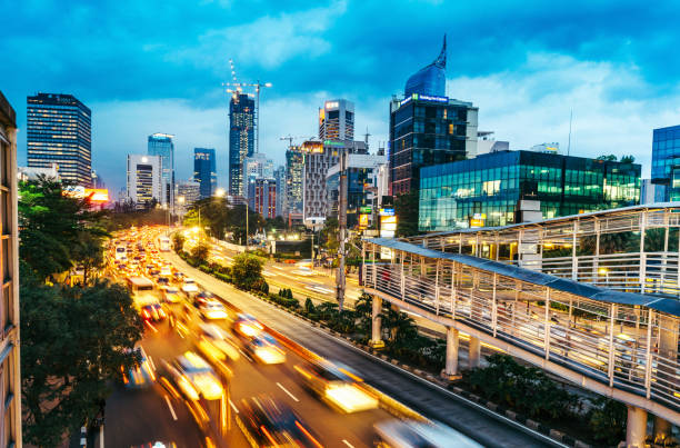 modern indonesia capital city Jakarta crowded street with many cars and motorcyles in Jakarta, Indonesia indonesia stock pictures, royalty-free photos & images