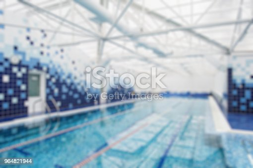Modern Indoor Light Swimming Pool Decorated With Blue Tiles Blur Background Stock Photo & More Pictures of Beauty