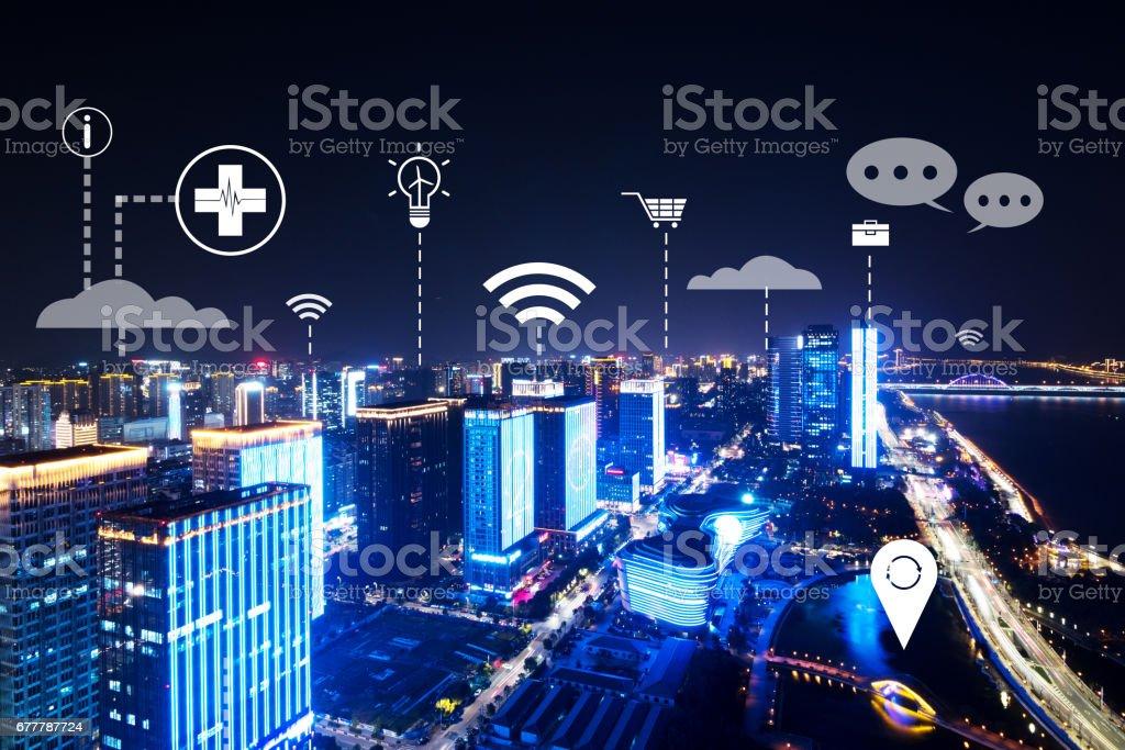 modern intelligence city near river at night stock photo