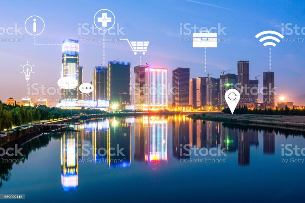 modern intelligence city near river at night stock photo