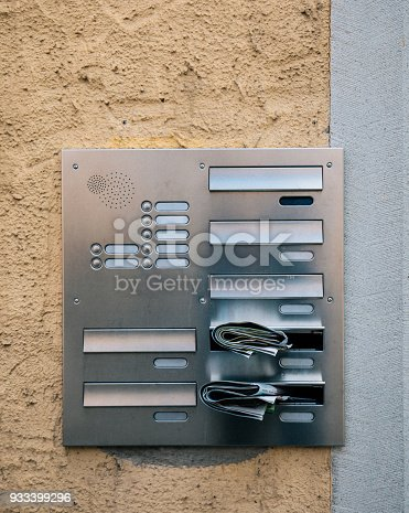 istock Modern intercom and postbox on wall 933399296