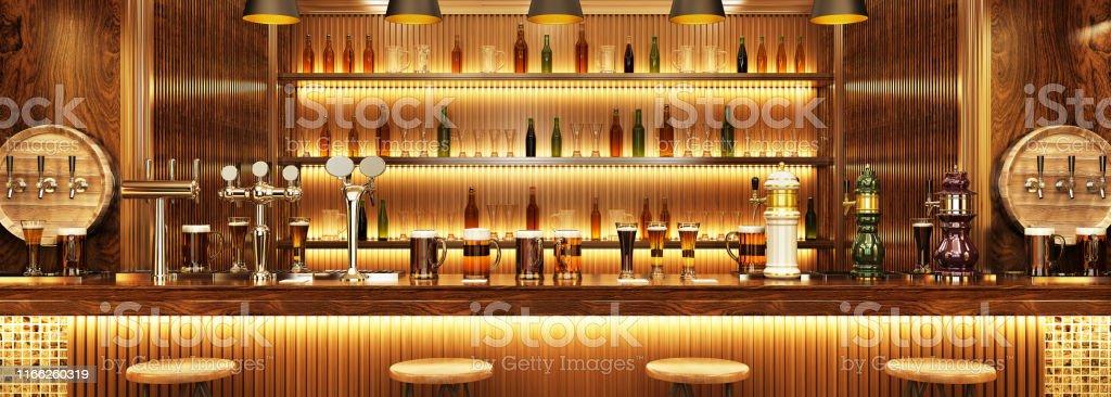 Modern interior design of a European pub. Beer on the bar - Zbiór zdjęć royalty-free (Alkohol - napój)