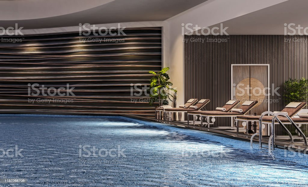 Modern interior design of indoor swimming pool with pool beds, night...
