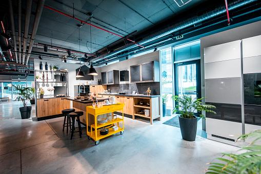 A modern interior kitchen design set up in a home improvement store