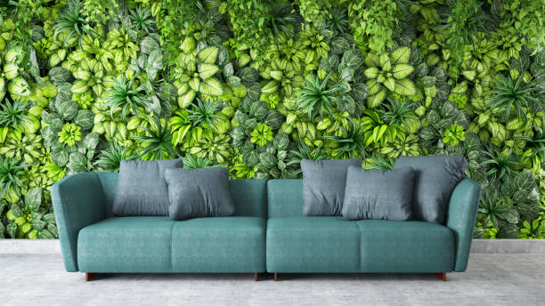 Modern interior Sofa with Green Plants on the Wall stock photo