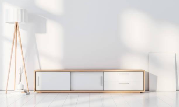 moderne innenwand mockup mit konsole für smart tv, plakat-standfuß, leere leinwand auf dem boden - wohnzimmergarnitur stock-fotos und bilder