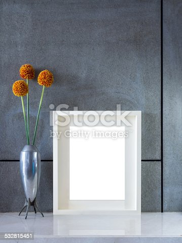 istock Modern interior wall with flowers vase and blank picture frame 532815451
