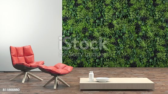 Modern interior, environmental theme, red armchair, coffee table, wooden floor, green plant garden wall in the background. letterbox composition. designer copy space template