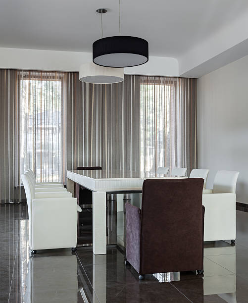 Modern interior with big table in daylight stock photo