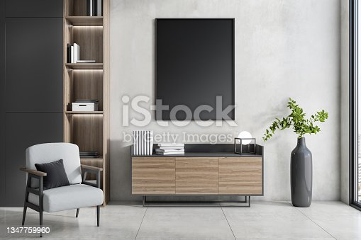 istock Modern interior with empty black mock up poster, wooden bookcase, armchair, decorative plant and window with city view. 3D Rendering. 1347759960