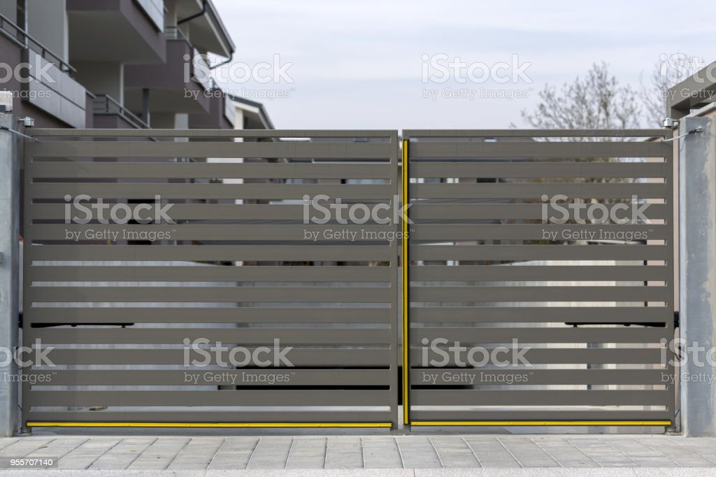 Modern iron home gate stock photo