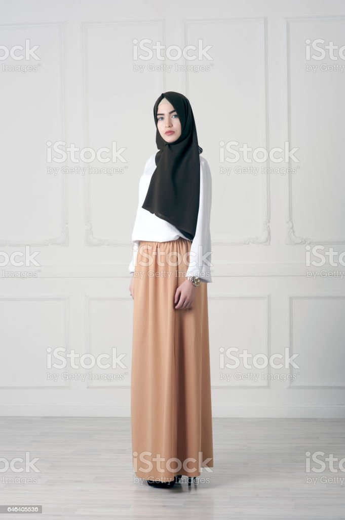 modern Islamic Muslim woman in fashionable dress in full growth stock photo