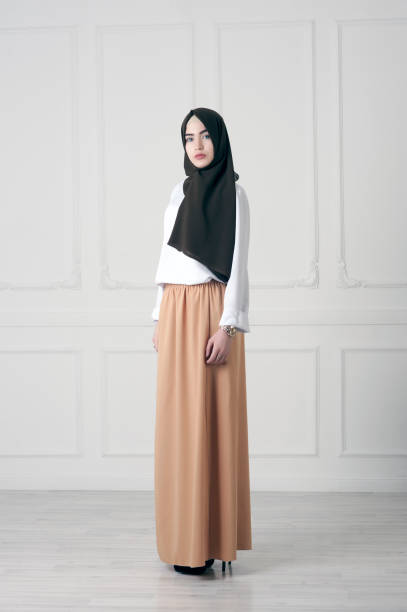 modern Islamic Muslim woman in fashionable dress in full growth stock photo
