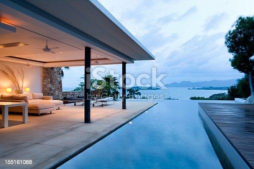Luxury Island Villa With Infinity Pool At Sunset.