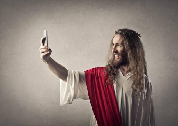moderna de jesus - ironía fotografías e imágenes de stock