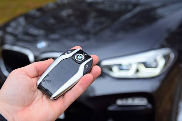 Modern key to the BMW in a hand stock photo