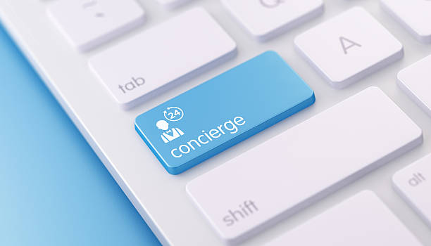 Modern Keyboard wih Concierge Button High quality 3d render of a modern keyboard with concierge button on a blue background and copy space. The concierge keyboard button has a text  and an icon on it. The concierge keyboard button is  in focus, concierge stock pictures, royalty-free photos & images