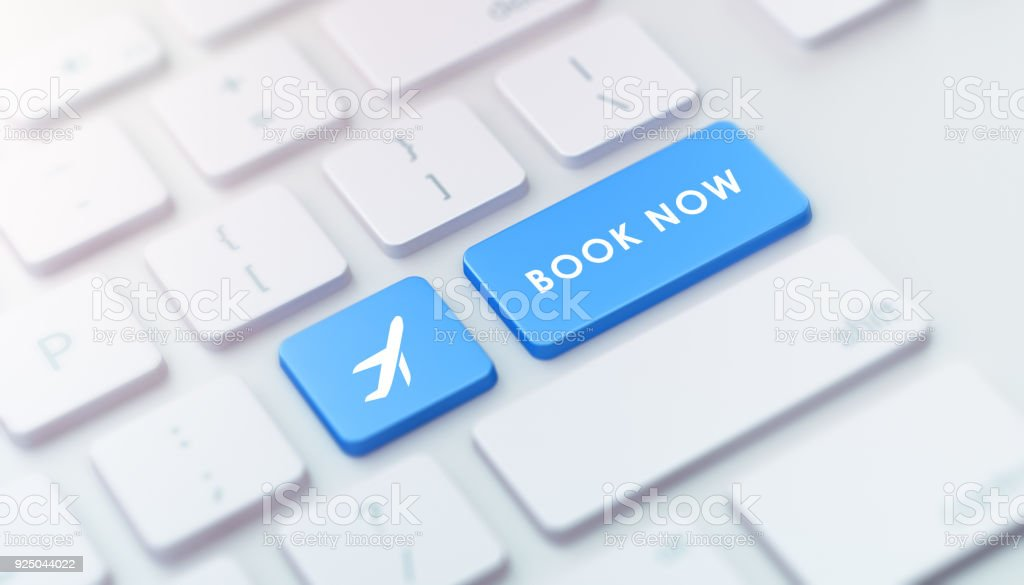 Modern Keyboard with Blue Book Now Button stock photo