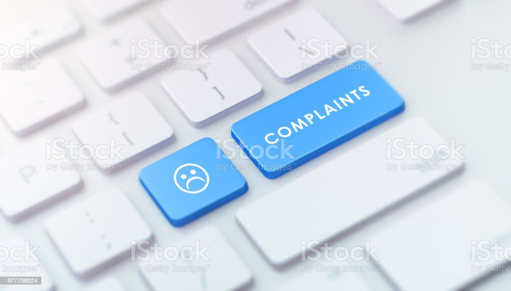 Modern Keyboard with Blue Complaints Button stock photo