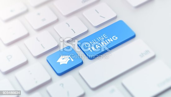 istock Modern Keyboard with Blue Online Training Button 925486634
