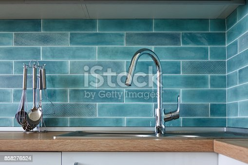 607472174 istock photo Modern kitchen, a picture of a faucet 858276524