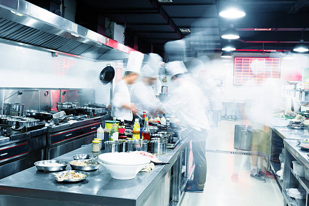 modern kitchen and busy chefs - busy restaurant kitchen stock pictures, royalty-free photos & images