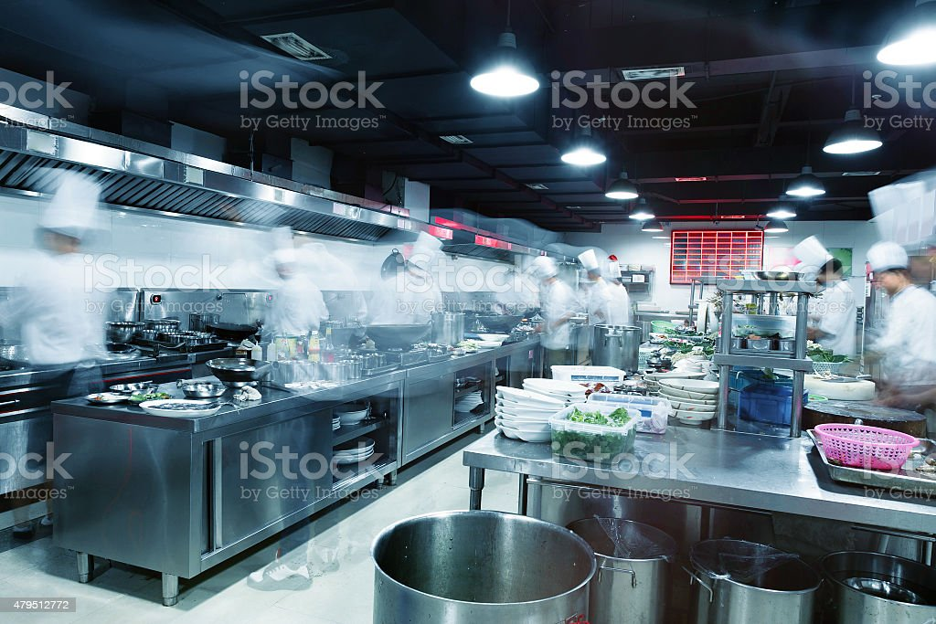 ... Modern Kitchen And Busy Chefs Stock Photo ...