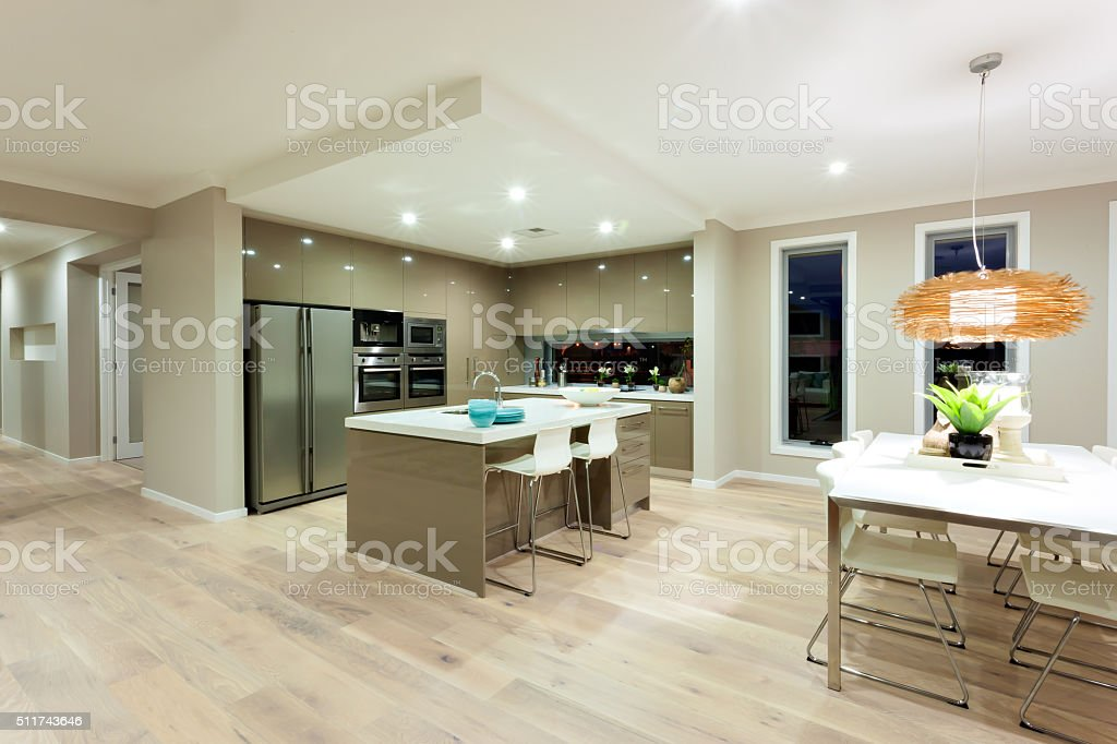 Modern kitchen and dining area interior view stock photo
