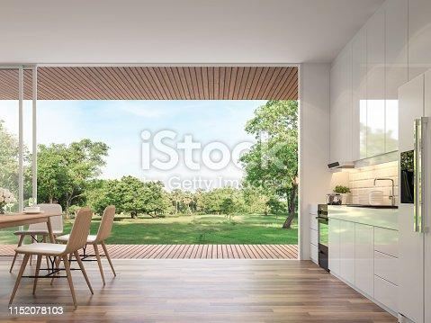 1140293905 istock photo Modern kitchen and dining room with nature view 3d render 1152078103
