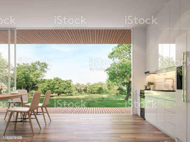 Modern Kitchen And Dining Room With Nature View 3d Render Stock Photo - Download Image Now