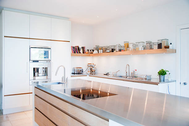 Modern kitchen and stainless steel counters stock photo