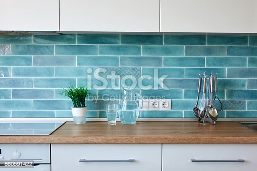 607472174 istock photo Modern kitchen at home with kitchenware 860591422