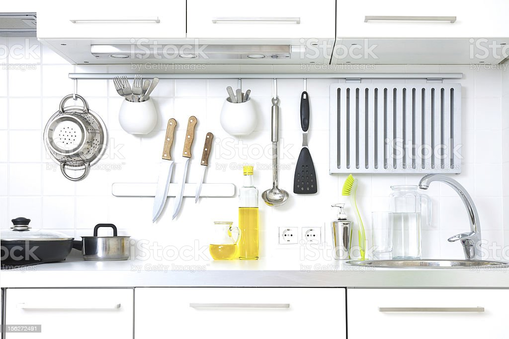 A modern kitchen complete with cooking utensils stock photo