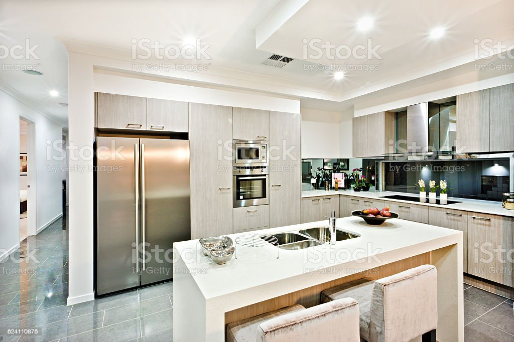Modern Kitchen Counter Top With A Fridge And Pantry Stock Photo ...