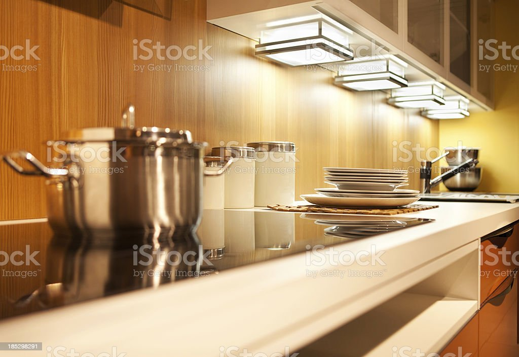 Modern kitchen counter top with pots and platesSimilar photos in...