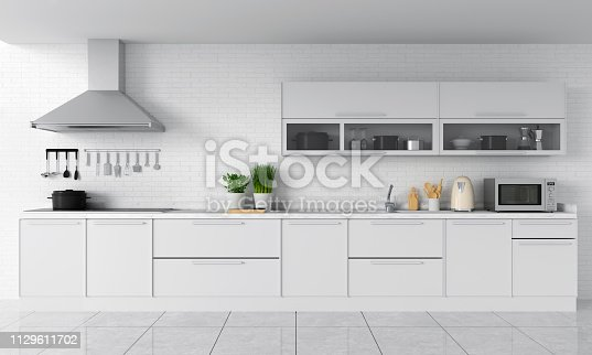istock Modern kitchen countertop and electric induction stove, 3D rendering 1129611702